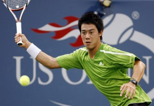 Nishikori of Japan returns a shot to Ferrer of Spain during their match at the U.S. Open tennis tournament at Flushing Meadows in New York