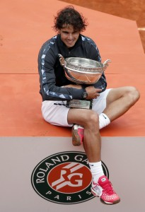 Spain's Rafael Nadal poses with his trop